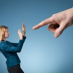 Image of woman being pointed at